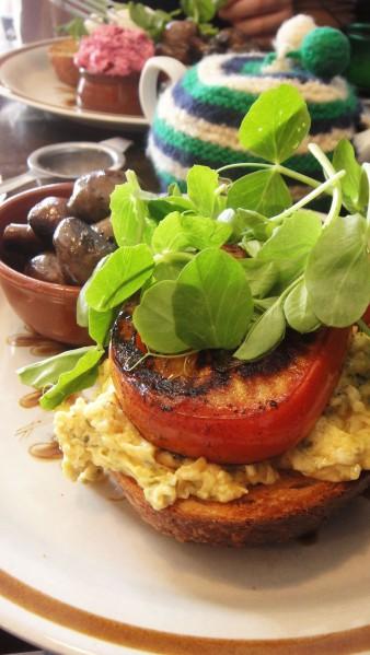 Pesto Scrambled Eggs ($16) w/ Mushrooms ($4.50)